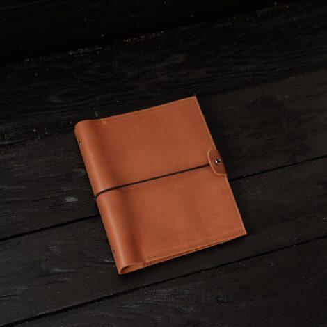 коричневый кожаный блокнот
