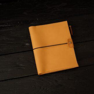 желтый кожаный блокнот